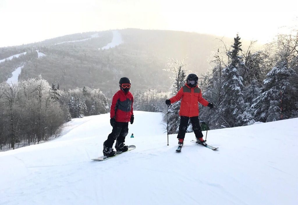 what to pack for family ski trip, kids skiing, snowboarding with kids, okemo vermont, family ski trip packing list